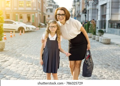 Outdoor portrait of a parent and children on the way to school