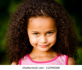 Outdoor portrait of pretty mixed race African-American girl