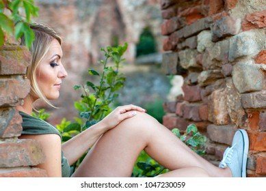 Outdoor portrait of a sad, moody or depressed, beautiful blonde woman
