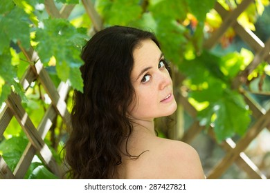 Outdoor portrait of sensual long-haired brunette young woman
