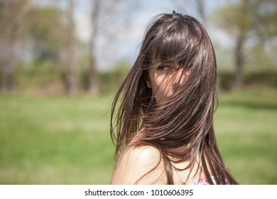Outdoor portrait of sexy women with dress in sunny day.