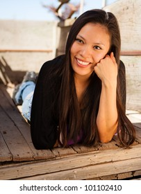 Outdoor portrait of a Smiling American Indian Girl