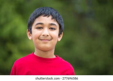 Outdoor Portrait of a Smiling Little Boy