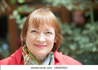 Outdoor portrait of smiling senior woman
