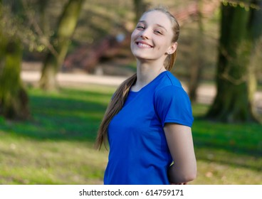 Outdoor portrait of smiling teen girl in the city park