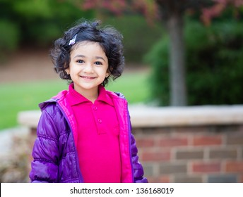 Outdoor Portrait of a Smiling Toddler Girl
