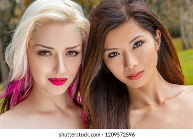 Outdoor portrait of two beautiful young women or girls one blonde and one Chinese Asian