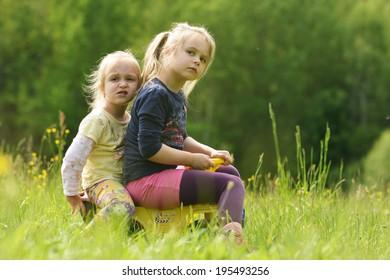 Outdoor portrait of two cute little girls
