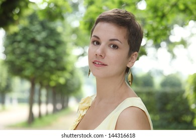 Outdoor portrait of young attractive happy young woman