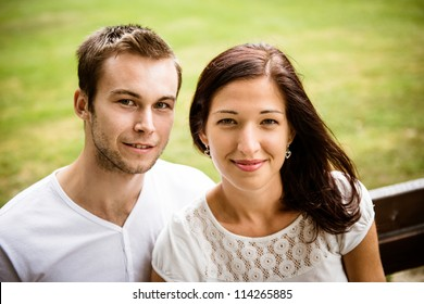 Outdoor portrait of young beautiful happy smiling couple