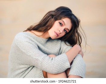 Outdoor portrait of a young beautiful romantic woman