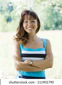 Outdoor portrait of young brunette woman