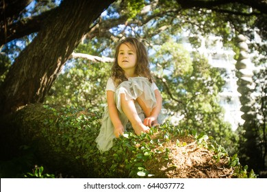outdoor portrait of young child girl in magic forest, outdoor natural background