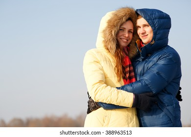 Outdoor portrait of young couple in cold winter weather.