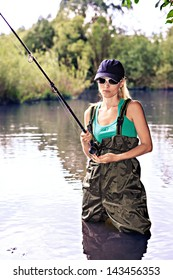 the outdoor portrait of a young fishing woman