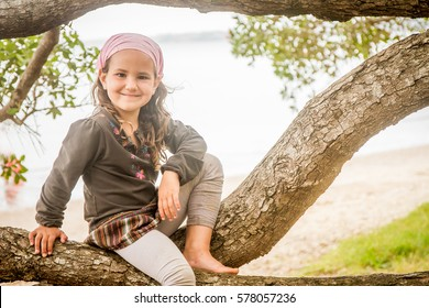 outdoor portrait of young happy smiling child girl having fun on natural background