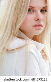 Outdoor portrait of young sensual beauty girl closeup