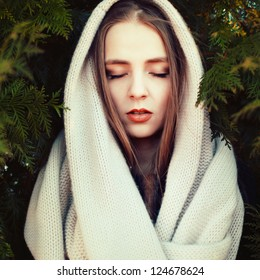 Outdoor portrait of young sensual woman with closed eyes