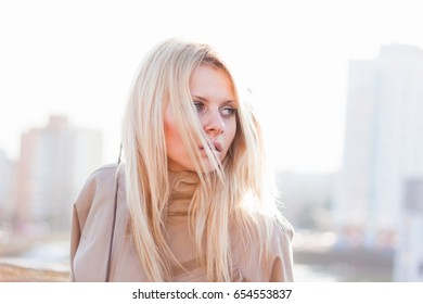 Outdoor portrait of young sensual woman in the hood closeup.