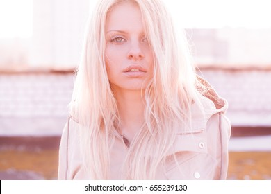Outdoor portrait of young sensual woman in sun-rays