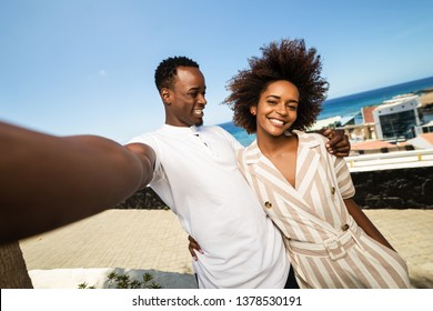 Outdoor protrait of black african american couple  taking a selfie