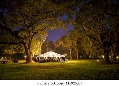 outdoor reception under tent and trees at night