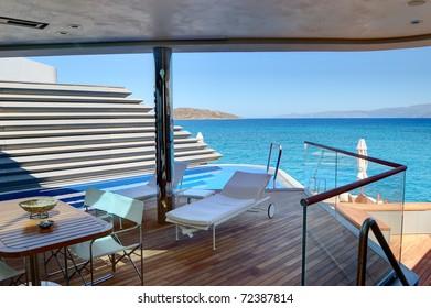 Outdoor recreation area of holiday villa at luxury hotel, Crete, Greece