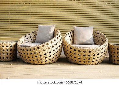 Outdoor relaxing space with twin rattan sofas inside the area