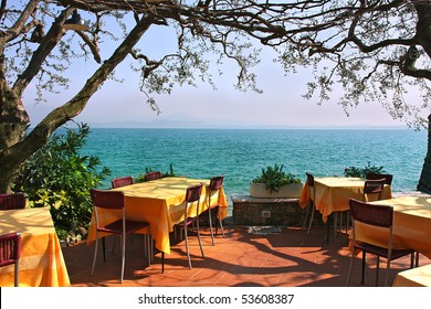 An outdoor restaurant with beautiful view on Lake Garda in Sirmione, Italy.
