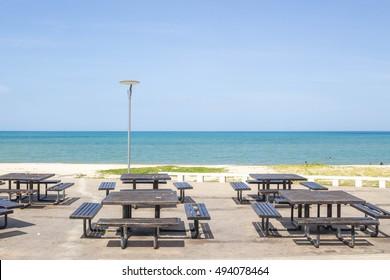 outdoor restaurant chair on the blue beach