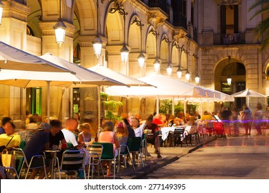 Outdoor restaurants at Placa Reial in  night. Barcelona