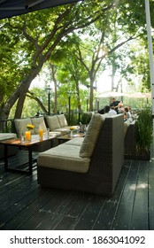 Outdoor restaurnt patio with comfortable couches.
