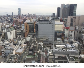 Outdoor scenic view of downtown of Shinsaibashi walking street in Osaka, Japan in March 18 2018. It's one of famous shopping area in Osaka, Japan. Numerous skyscrapers also shown from rooftop view.