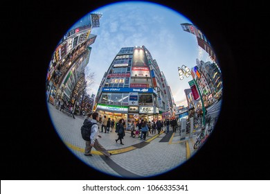 Outdoor scenic view at Shinjuku business zone in downtown of Tokyo, Japan at twilight in March 15 2018. Pedestrians walking around numerous skyscrapers. Fisheye lens uses for the special plate effect.