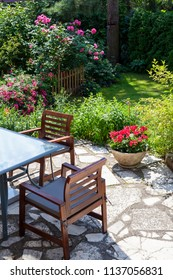 Outdoor seating area with summer garden in full bloom