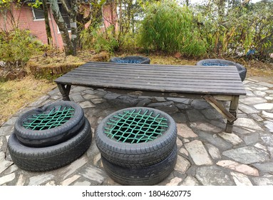Outdoor seating composed of chairs and tables made by reusing old stuffs like tires and ropes to make chairs.
