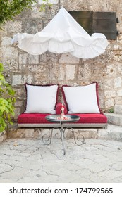 Outdoor seating on cushions in little cafe in Mostar, Bosnia