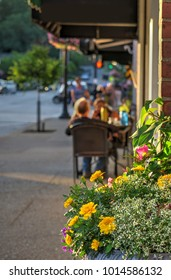 Outdoor Seating at a Sidewalk Cafe in the Small Upscale Tourist Town of Chagrin Falls, Ohio Taken on a Sunny Late Afternoon in Summer