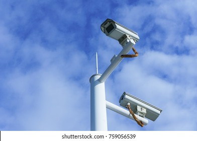 Outdoor security cctv camera against blue sky and cloud
