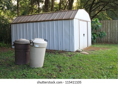 Outdoor shed with covered trash cans