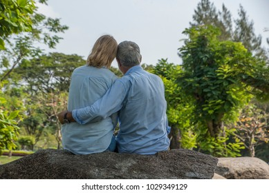 Outdoor shot of loving senior couple having fun and relax in park