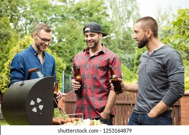 Outdoor shot of three friends enjoying barbecue party.