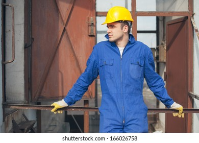 Outdoor shot of a young Caucasian construction worker.