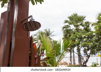 Outdoor shower at swimming pool.  shower cabins behind outdoor swim pool .Outdoor shower area design at the beach, seaside or swimming pool. For person to take a bath and clean up from sea water.