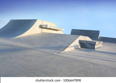 outdoor skatepark with blue sky and grey concerete in harwich, essex, uk