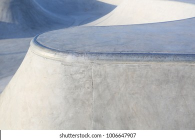 outdoor skatepark with blue sky and grey concrete in harwich, essex, uk