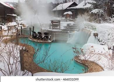 An outdoor spa is covered in snow in Ontario, Canada