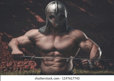 outdoor sport Brutal strong muscular men with sword, bladepumping up muscles workout bodybuilding concept background - muscular bodybuilder handsome men knight, cavalier, chevalier naked torso