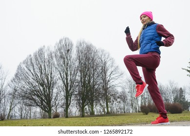 Outdoor sport exercises, sporty outfit ideas. Woman wearing warm sportswear training exercising outside during autumn.