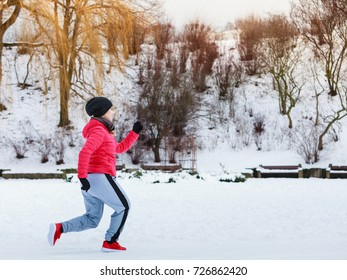 Outdoor sport exercises, sporty outfit ideas. Woman wearing warm sportswear training exercising outside during winter.